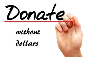 Hand writing Donate with marker, business concept